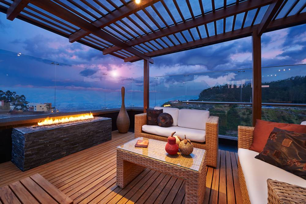 OUTDOOR ENTERTAINING: According to Mike Mortlock, an addition of a roofed outdoor relaxation and entertainment area will drive holiday makers to your home. Photo - Shutterstock.