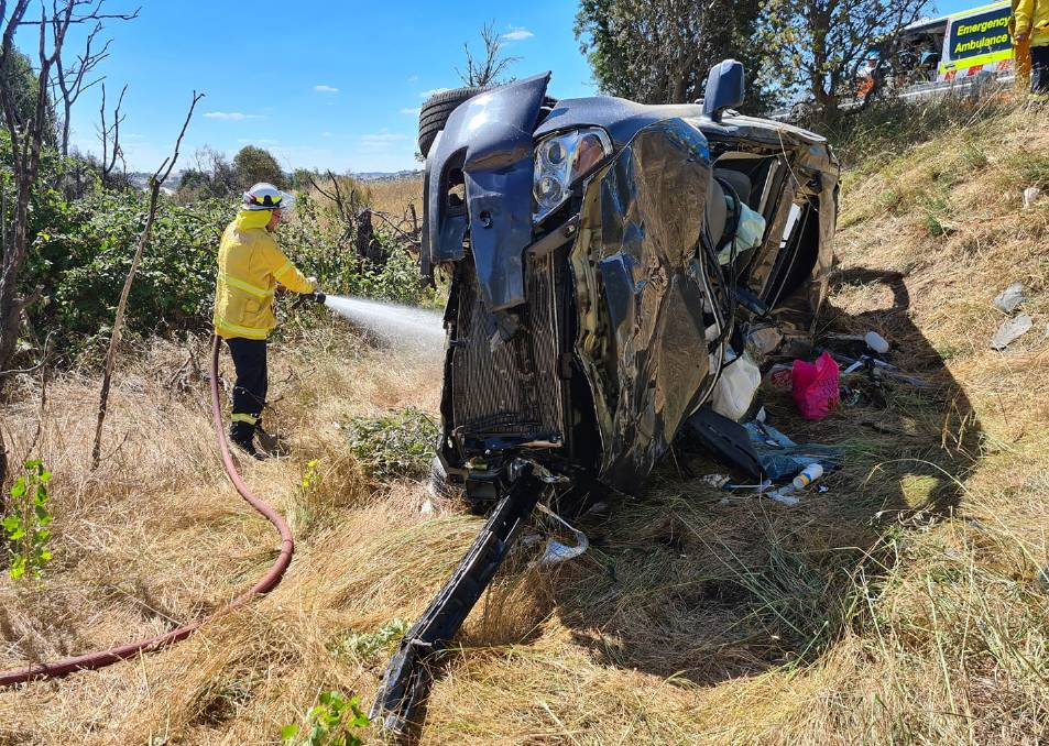 Gunning/Fish River RFS Brigade members were quickly on the scene of a vehicle rollover on the Hume Highway near Gunning on Saturday afternoon. Photo: Gunning/Fish River RFS.