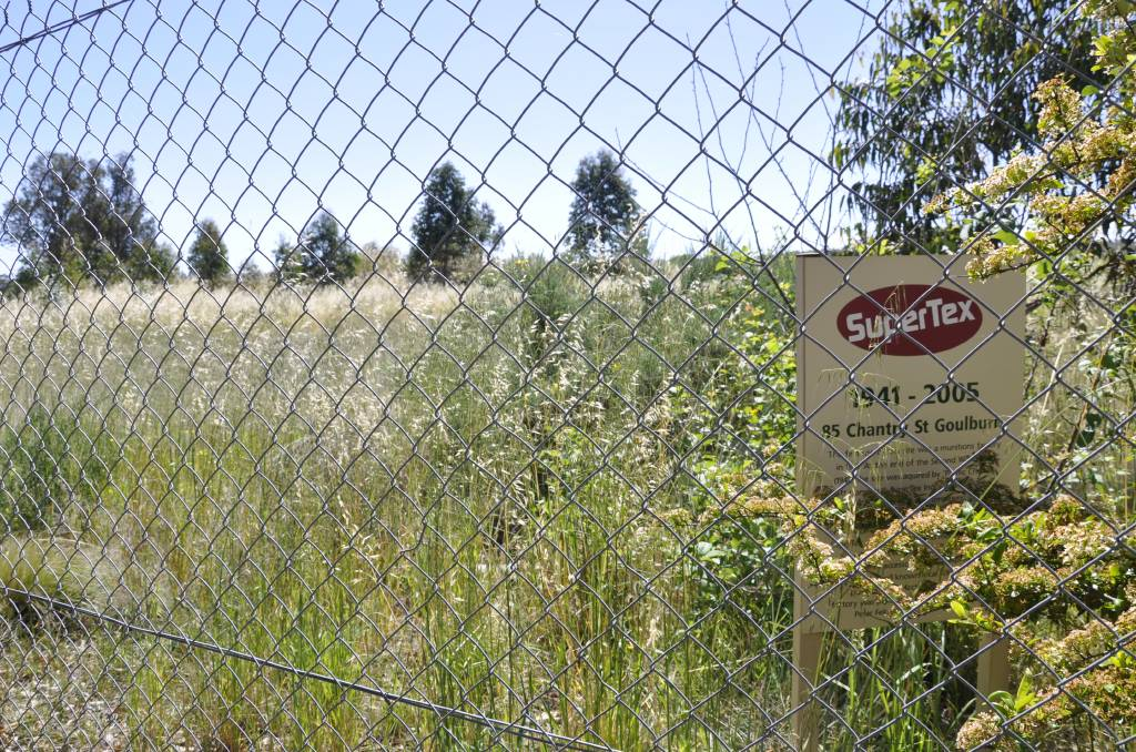 FIRE DANGER: The former Supertex site in Chantry Street also has long grass. The property was purchased for development purposes in 2004 but little has happened on the land. Photo: Louise Thrower.