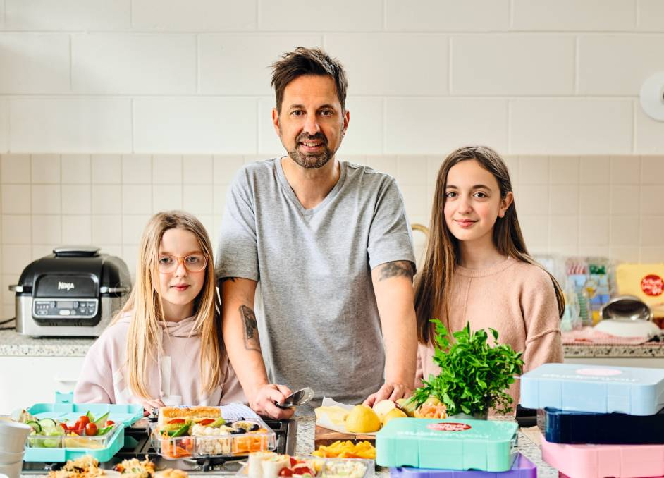 George Georgievski with his daughters Kiki and Anela. Picture: Nikole Ramsay