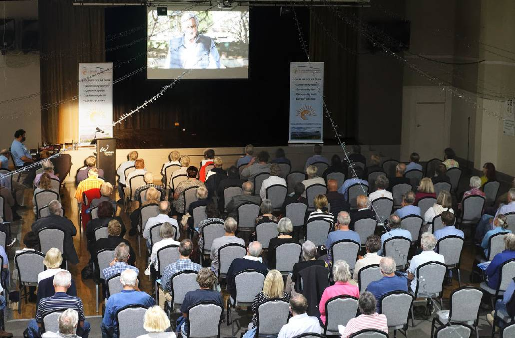 An attentive COVID-distanced audience watch an introductory video from John Hewson, CE4G chair and former Liberal leader. Picture: Nic Fraser.