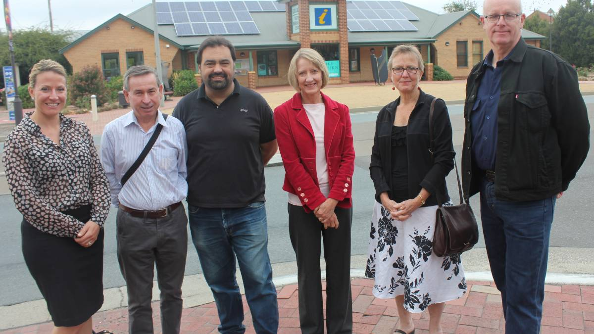 EXCITED: Goulburn Chamber of Commerce president Prue Martin (far left) joined with The Goulburn Group committee members Peter Fraser, Alex Ferrara, Mhairi Fraser, Jane Suttle and TGG president Urs Walterlin (right) in front of the solar panels on top of the Goulburn Visitor Information Centre.
