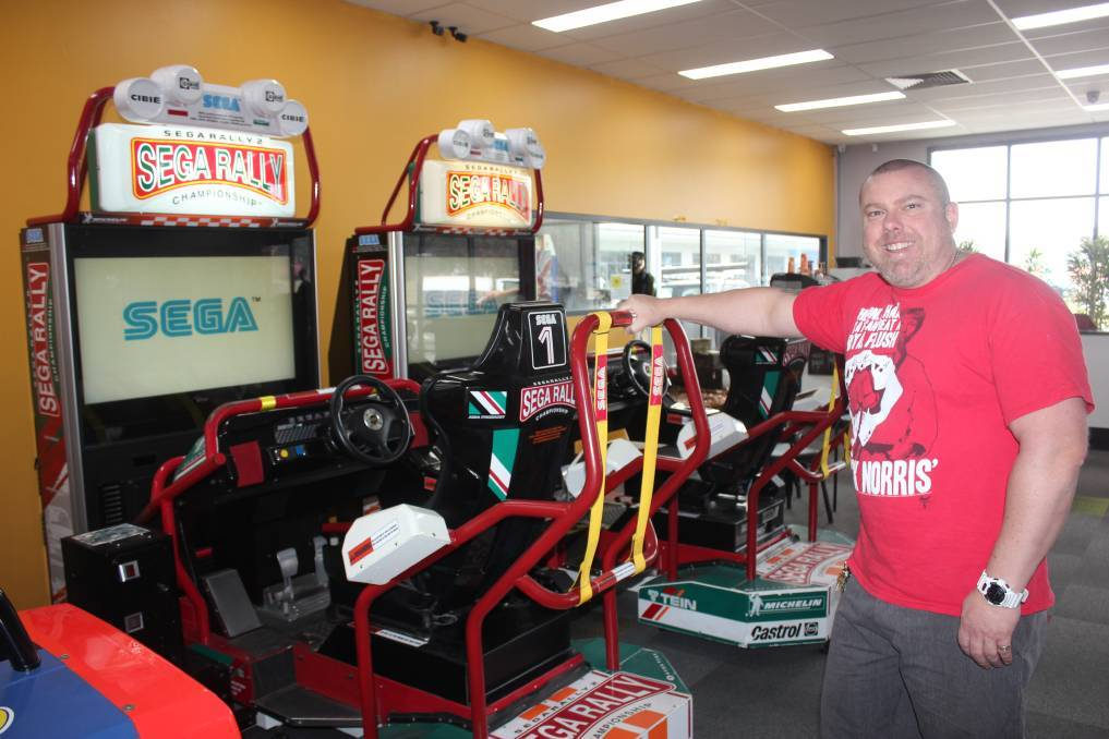 Greg Appleton with some of the Sega Rally racing car games at the old Back To The Arcade location. File pic: David Cole.